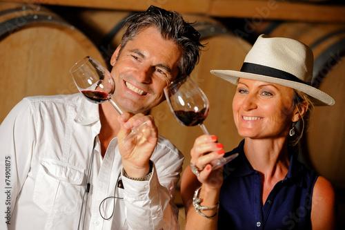 Leinwanddruck Bild Tourism - Couple tasting wine in a cellar
