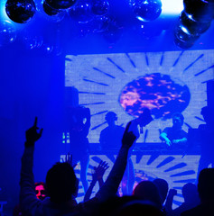 Silhouettes people dancing at nightclub