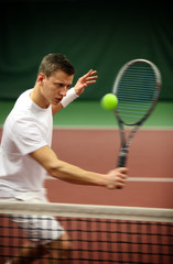 .Young man playing tennis