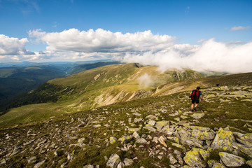 Hiker at Fagaras Mountains, Southern Carpathians, Romania