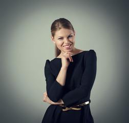 Fashion girl. Portrait of happy smiling elegant lady in dress