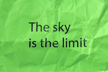 the sky is the limit text on green paper