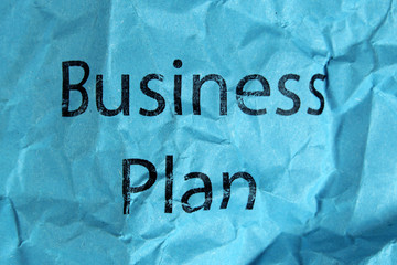 business plan text on blue paper