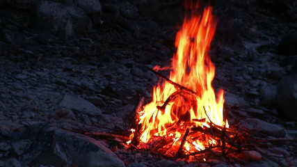 camp fire on the river bank