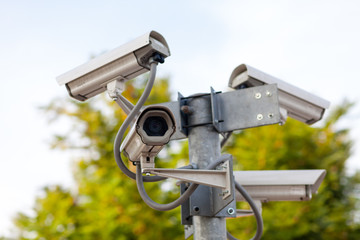 four CCTV cameras on the junction