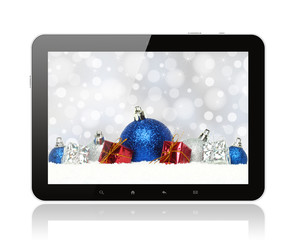 Tablet PC with Christmas decorations on white background .
