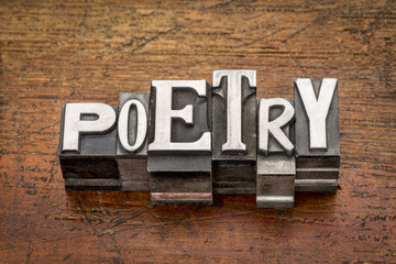 poetry word in metal type