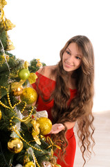 attractive lady at christmas tree