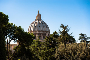 St Peter's Basilica on blue sky background. Vatican, Italy
