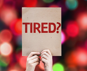 Tired? card with colorful background with defocused lights