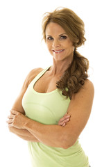 mature woman green fitness arms folded smile