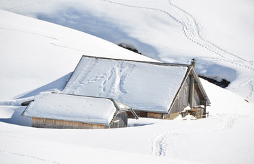 Little house buried under snow, Melchsee-Frutt, Switzerland