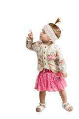 Young girl looking and pointing up at corner