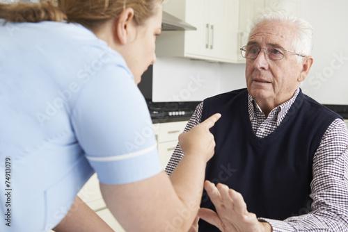 Leinwanddruck Bild Care Worker Mistreating Elderly Man