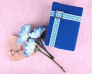 Happy Father's Day with gift box, flowers and piece of paper