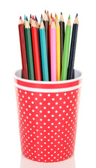 Colorful pencils in red polka-dot plastic cup isolated