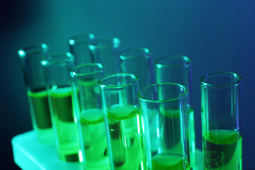Green fluid in test-tubes on the dark background