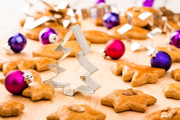 Christmas gingerbread cookies with cutters and baubles.