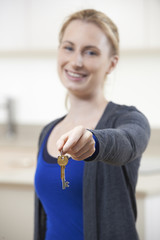 Happy Young Woman Holding Keys To New Home