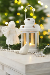 Christmas decorations with lantern on fir tree background