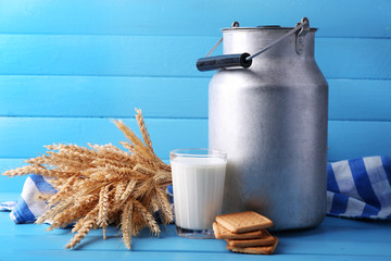 Retro can for milk, milk glass, cookie and sheaf