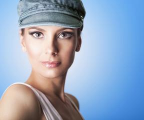 Portrait of beautiful woman, wearing cap.,shoot in studio.