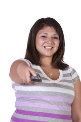 Teenage Girl changing the Channel with Remote Control