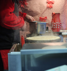 Man making french crepe at Christmas market