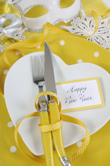 Yellow and white Happy New Year table place setting.