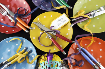 Colorful Happy New Year dinner party table place settings