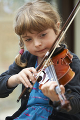 Young Girl Learning To Play Violin