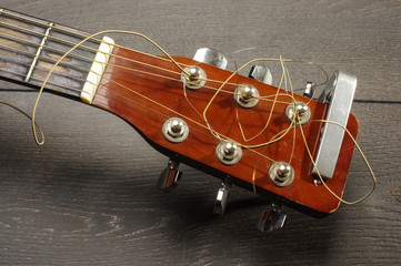 Close up of guitar head with tuning pegheads