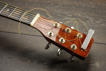 Front view of acoustic six string guitar isolated
