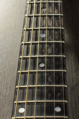 Acoustic guitar fretboard perspective