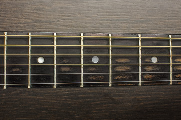 Acoustic guitar frets close up