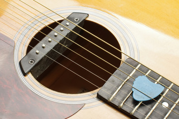 Guitar sound hole and blue guitar pick