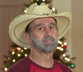 A Bearded Cowboy by a Christmas Tree