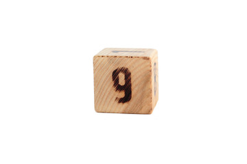 number 9 on the wooden cube