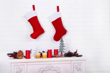 Christmas socks hanging on wall above fireplace