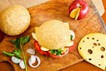 Delicious burger with fruits and vegetables