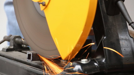 Machine cutting a metal object.