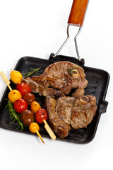 Lamb Chops with cherry tomato. Selective focus.