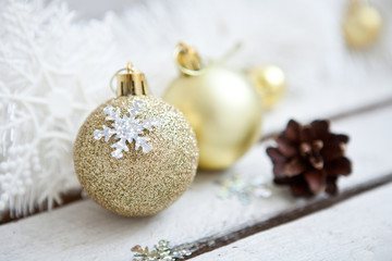 Close up of several Christmas gold glass baubles