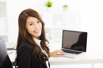 happy young business woman working in the office