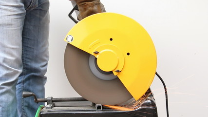 Machine cutting a metal object.