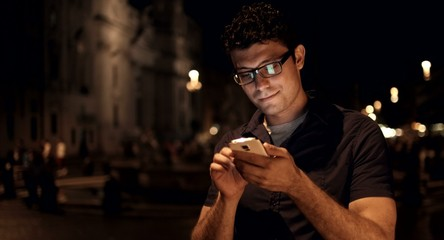 Using Smartphone Vacation Europe Young Man Smiling Happy