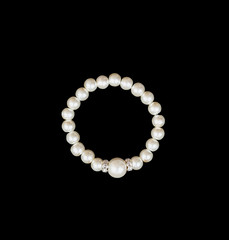 White pearls on the black background