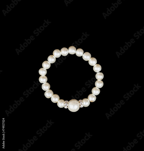 White pearls on the black background - 74927024