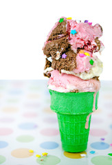 dripping ice cream cone with star sprinkles