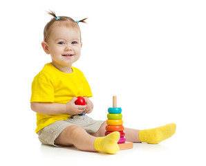happy baby playing with colorful wood pyramid isolated